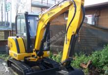 escavatore gommato JCB usato