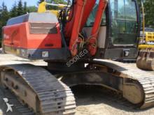 escavadora sobre rastos O&K usada