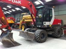 escavadora sobre pneus O&K usada
