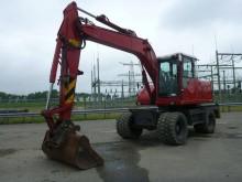 escavadora sobre pneus Volvo usada