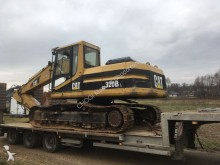 Caterpillar 320BL with a damaged engine