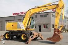excavator pe roti New Holland second-hand