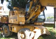 escavatore gommato Case usato