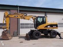 excavator pe roti Caterpillar second-hand