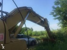 damaged Caterpillar track excavator