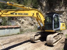 Vedere le foto Escavatore New Holland E245