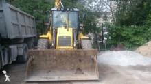 buldoexcavator rigid New Holland second-hand