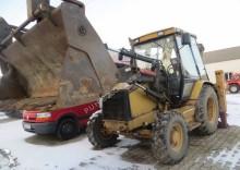 buldoexcavator rigid Caterpillar