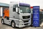 MAN TGX 18.680 XXL V8 4x2 AT-Motor mit Hydraulik tractor unit