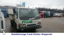 camión volquete trilateral Isuzu