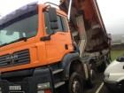 camión volquete escollera MAN usado