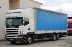 gebrauchter Scania LKW Pritsche und Plane Schiebeplanenaufbau