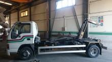 camión multivolquete Isuzu usado