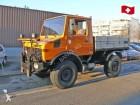 camión volquete trilateral Unimog usado