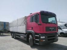 camión lona corredera (tautliner) caja abierta entoldada MAN usado