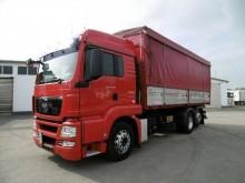 camión volquete para cereal MAN usado