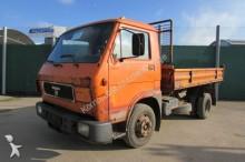 camión volquete trilateral MAN usado