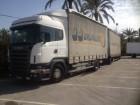 camion cu remorca cu prelata si obloane Scania second-hand