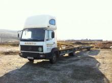 camion cu remorca pentru transport autovehicule Mercedes second-hand