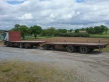 camion cu remorca platformă transport baloti Iveco second-hand
