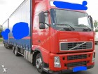 camion cu remorca cu prelata si obloane Volvo second-hand
