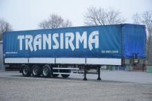 used Fruehauf dropside flatbed tarp semi-trailer