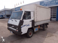 used FAAM tarp covered bed flatbed van