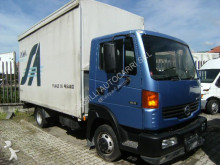 used Nissan tarp covered bed flatbed van
