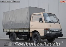 Nissan tarp covered bed flatbed van