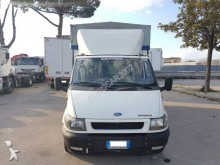 used Ford tarp covered bed flatbed van