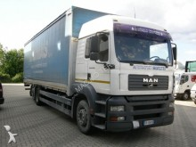 used MAN tarp covered bed flatbed van