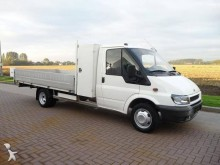 Ford tarp covered bed flatbed van