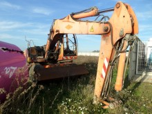 damaged wheel excavator