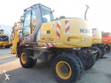 escavatore gommato New Holland