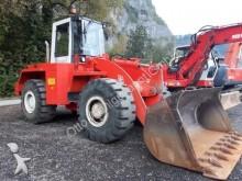escavadora sobre pneus O&K
