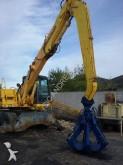 escavadora de grifa manutenção Furukawa
