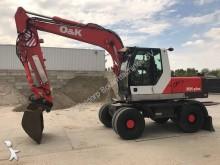 escavatore gommato O&K