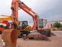 escavadora sobre pneus Atlas