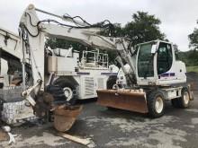 escavatore gommato New Holland