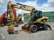 Caterpillar M316D Hammer/Greiferleitung Klima Schild und Pratz