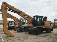 escavatore per movimentazione Caterpillar