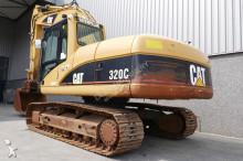 escavatore intermediario strada/rotaia Caterpillar