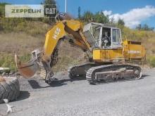 escavatore Demag H55
