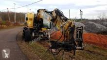 pelle rail/route accidenté