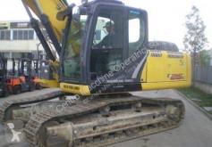 Vedere le foto Escavatore New Holland E215C T
