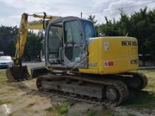 Vedere le foto Escavatore New Holland