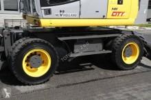 Vedeţi fotografiile Excavator New Holland WHEEL EXCAVATOR 16 T NEW HOLLAND MH CITY