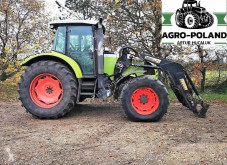 zemědělský traktor Claas ARES 657 ATZ - ŁADOWACZ - SILNIK JOHN DEERE 135 KM