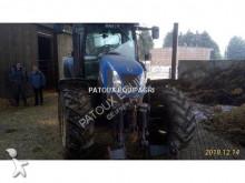 Voir les photos Tracteur agricole New Holland TSA 125