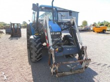 View images New Holland TS100 farm tractor